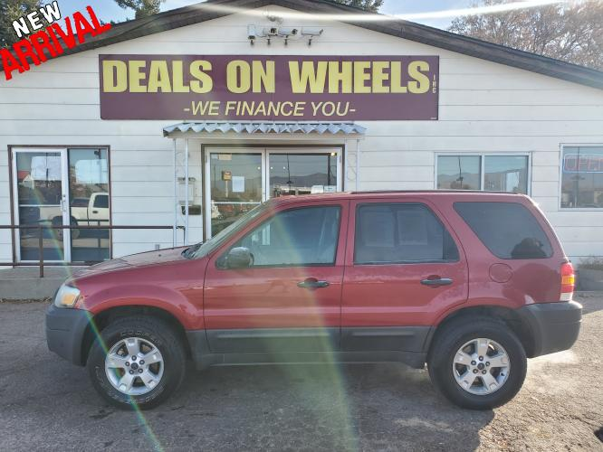 2005 Red Ford Escape XLT 4WD (1FMYU93175K) with an 3.0L V6 DOHC 24V engine, 4-Speed Automatic Overdrive transmission, located at 1800 West Broadway, Missoula, MT, 59808, (406) 543-1986, 46.881344, -114.021065 - Photo #0